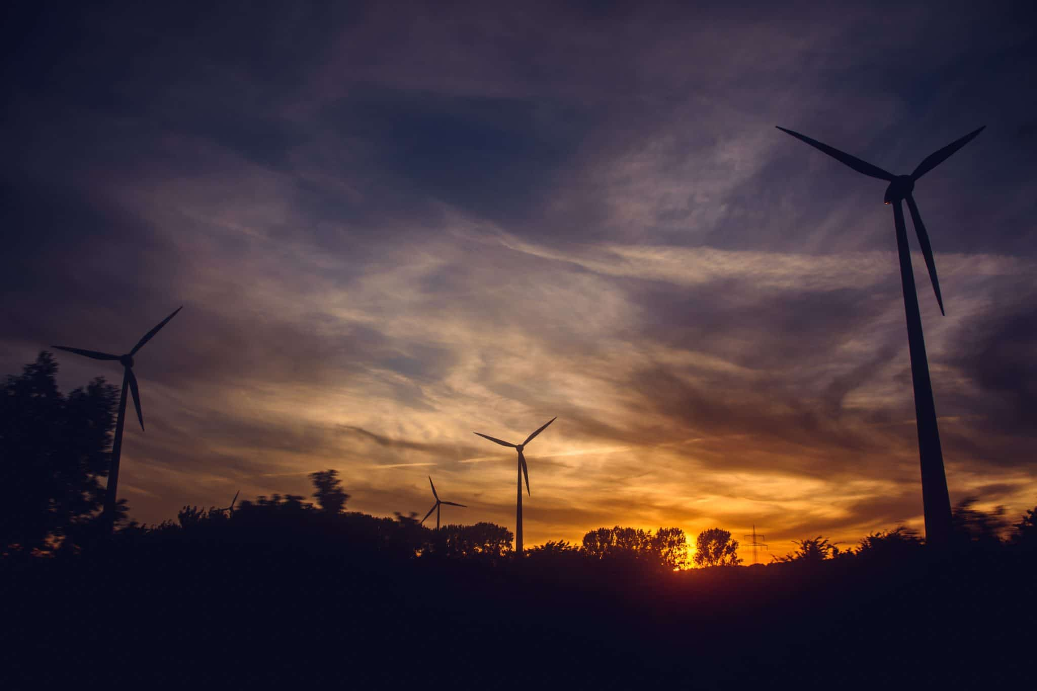 Wind farm at dusk - Photo by Irina Iriser from Pexels