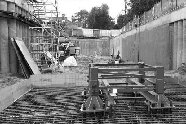 The Markham concrete waterproofing system is shown in a basement under construction