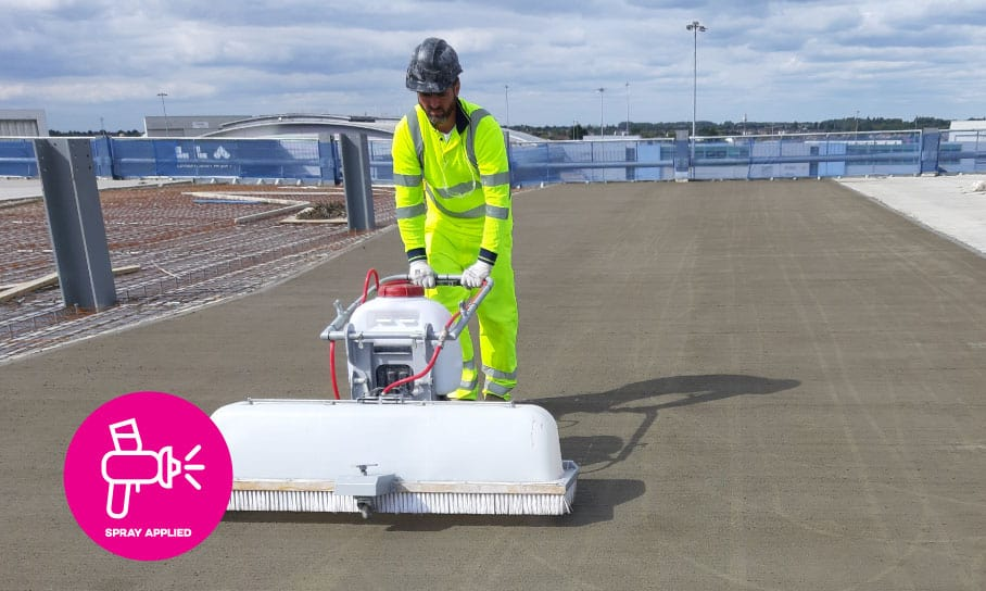 An advanced hydrogel waterproofing sealer being spray applied to a concrete car park floor slab